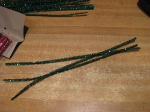 Start with pipe cleaners. I found some red, green, and silver sparkly ones at the craft store for Christmas. Blue and silver could be used for Chanukah. You could also do this for any other holiday/time of year.