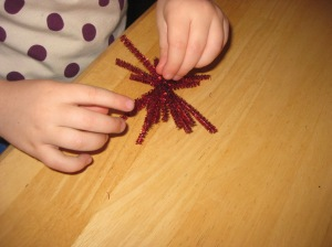 Have the kids separate the strands out so it looks like a star, snowflake, etc.